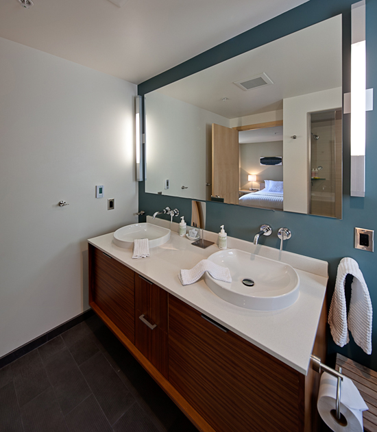 Spa INNspired steam shower, dual sink vanity and heated floors too