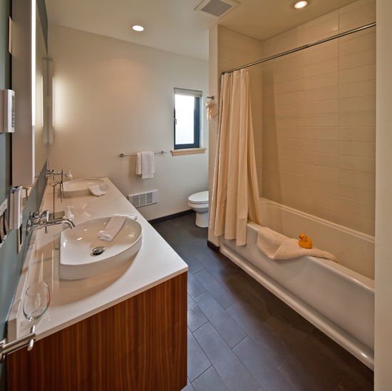 Two full bathrooms; one with a tub and one with a steam shower