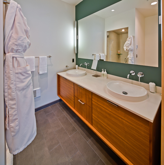 A spa inn-spired steam shower, dual sink vanity and the floors are heated too