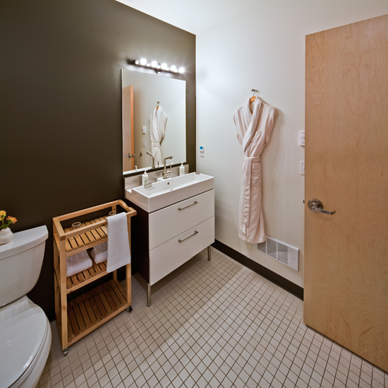 Private washroom with corner shower